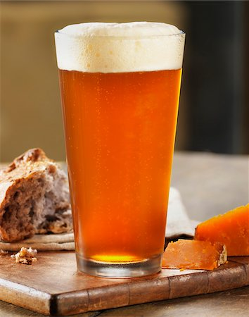 Glass of Beer with Bread and Cheese on Breadboard, Studio Shot Stock Photo - Premium Royalty-Free, Code: 600-07810549