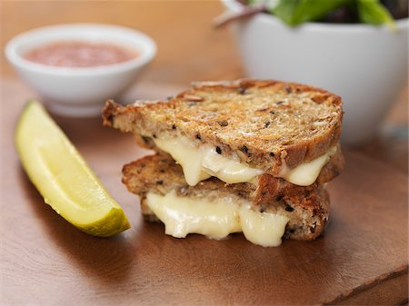 Grilled Brie Cheese Sandwich with Ketchup, Pickle and Salad, Studio Shot Stock Photo - Premium Royalty-Free, Code: 600-07810540