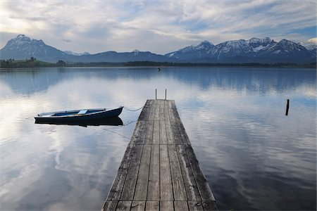 Wooden Jetty with Rowboat, Hopfen am See, Lake Hopfensee, Bavaria, Germany Stock Photo - Premium Royalty-Free, Code: 600-07844555