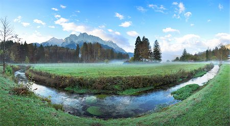 Landscape of the highest Mountain in Germany (Zugspitze) in the distance, on an early morning in autumn, view from Tirol, Austria Stock Photo - Premium Royalty-Free, Code: 600-07911184