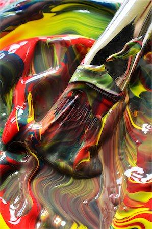 Close-up of paint swirls and brush Stock Photo - Premium Royalty-Free, Code: 600-07911205
