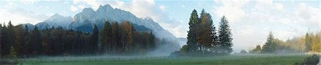 Landscape of the highest mountain in Germany (Zugspitze) in the distance, on an early morning in autumn, view from Tirol, Austria Stock Photo - Premium Royalty-Free, Code: 600-07911257