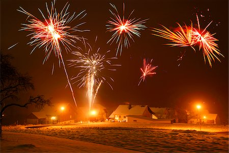 Celebrating New Year's Eve with Fireworks in Village, Bavaria, Germany Stock Photo - Premium Royalty-Free, Code: 600-07944999