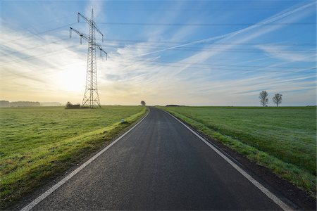 power - Country Road with Electricity Pylon in Morning with Sun, Freiensteinau, Vogelsbergkreis, Hesse, Germany Stock Photo - Premium Royalty-Free, Code: 600-07945038