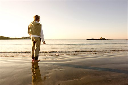 A man pauses while skipping rocks into the water at Bailey's Beach on an autumn morning, Newport, Rhode Island, USA. Stock Photo - Premium Royalty-Free, Code: 600-07945074