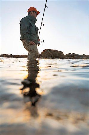 fishing - Man fishing along the coast of Rhode Island, USA Stock Photo - Premium Royalty-Free, Code: 600-07945086