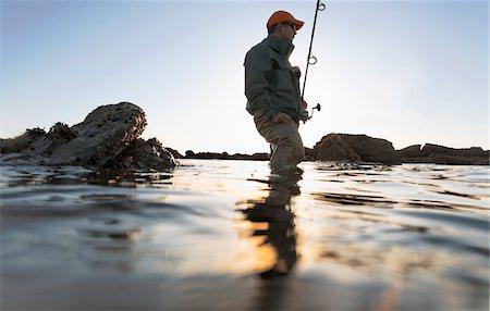 fishing - Man fishing along the coast of Rhode Island, USA Stock Photo - Premium Royalty-Free, Code: 600-07945087
