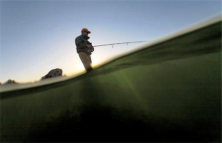 fishing - Low angle view of man fishing along the coast of Rhode Island, USA Stock Photo - Premium Royalty-Free, Code: 600-07945082
