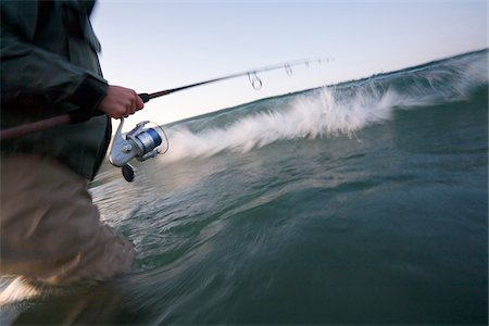 fishing - Close-up of man casting for stripers in the surf at Sachuest Beach along the coast of Rhode Island, USA Stock Photo - Premium Royalty-Free, Code: 600-07945083