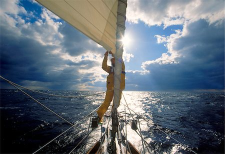Man adjusting the jib while sailing offshore on the Atlantic Ocean. Stock Photo - Premium Royalty-Free, Code: 600-07945122