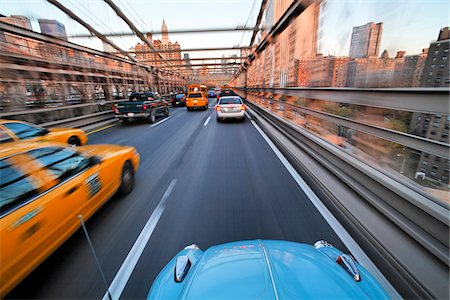 Driving over the Brooklyn Bridge in a VW Beetle towards Manhattan, New York City, New York, USA. Stock Photo - Premium Royalty-Free, Code: 600-07945136