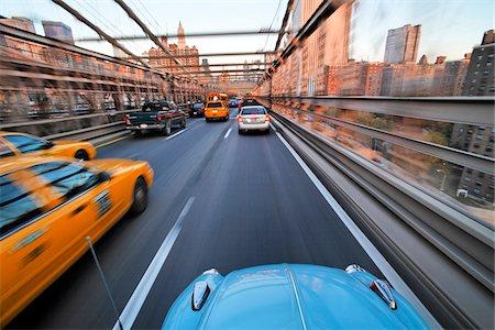 Driving over the Brooklyn Bridge in a VW Beetle towards Manhattan, New York City, New York, USA. Stock Photo - Premium Royalty-Free, Code: 600-07945136