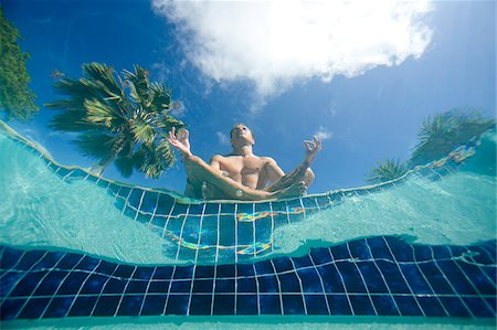 sitting under tree - Man doing yoga poolside, view from underwater, Antigua, Caribbean Stock Photo - Premium Royalty-Free, Code: 600-07945145