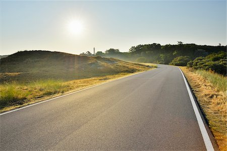 european (places and things) - Country Road with Sun in Summer, Norderney, East Frisia Island, North Sea, Lower Saxony, Germany Stock Photo - Premium Royalty-Free, Code: 600-07945241