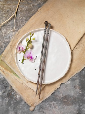 slate - Orchid Flower on White Plate with Chopsticks on Canvas Cloth and Slate Background, Studio Shot Stock Photo - Premium Royalty-Free, Code: 600-07945379