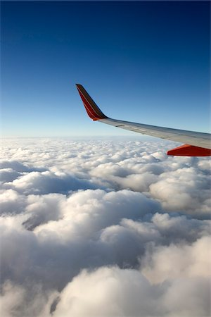 View from Window of Southwest Airlines Jet while Flying over Clouds Stock Photo - Premium Royalty-Free, Code: 600-07965837