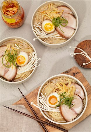 Noodle soup with pickled egg, pork, tofu, mushrooms and green onions. Stock Photo - Premium Royalty-Free, Code: 600-07965935