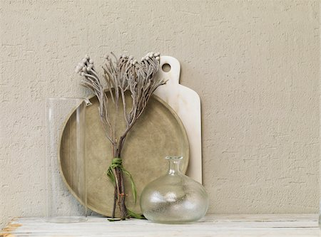 Still life of dried twigs with glass vase, platter and marble board. Stock Photo - Premium Royalty-Free, Code: 600-07965941