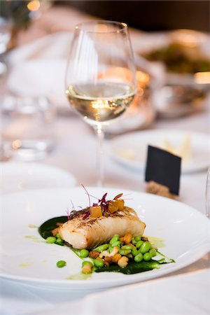 Cod with Lima Beans and Glass of White Wine at Wedding Reception Stock Photo - Premium Royalty-Free, Code: 600-07991589