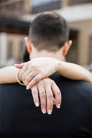 ring hand woman - Close-up of Bride's Hands around Groom, Hamilton, Ontario, Canada Stock Photo - Premium Royalty-Free, Code: 600-07991600