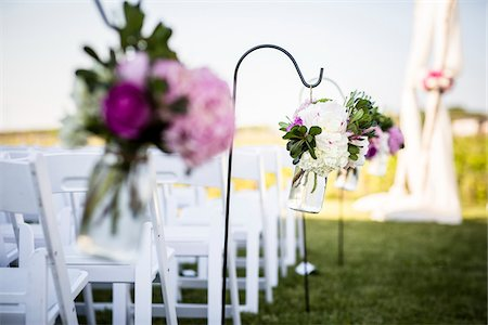 decorations - Flowers Hanging at End of Rows of Chairs at Wedding Stock Photo - Premium Royalty-Free, Code: 600-07991646