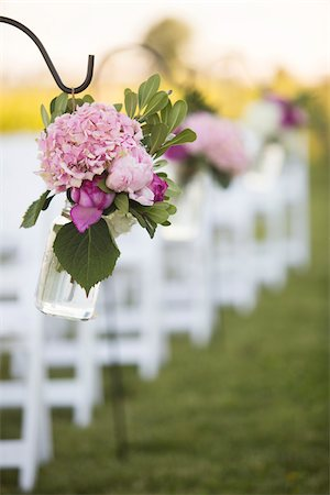 Flowers Hanging at End of Rows of Chairs at Wedding Stock Photo - Premium Royalty-Free, Code: 600-07991647
