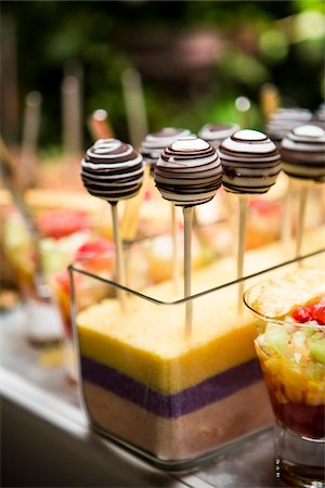 dessert - Close-up of Chocolate Lollipops and Glasses of Fruit Cocktail on Dessert Table Stock Photo - Premium Royalty-Free, Code: 600-07991666