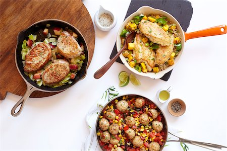 Three healthy skillet dinners with pork, meatballs and chicken, studio shot on white background Stock Photo - Premium Royalty-Free, Code: 600-08002129
