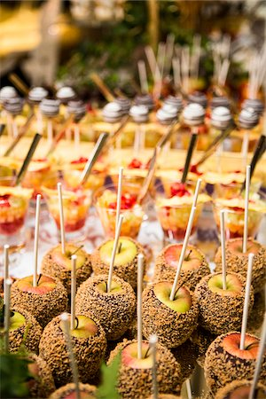 event - Close-up of Chocolate and Nut Covered Apples and Glasses of Fruit Cocktail on Dessert Table Stock Photo - Premium Royalty-Free, Code: 600-08002300