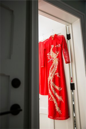 detail - Red, cheongsam dress hanging on door at entrance to a room, Canada Stock Photo - Premium Royalty-Free, Code: 600-08002544