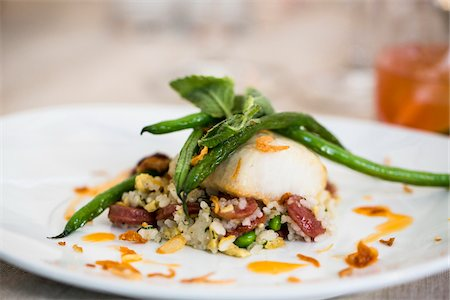 food - Close-up of black cod fish filet with a Chinese sausage and rice side dish and green beans on a dinner plate, at an event, Canada Stock Photo - Premium Royalty-Free, Code: 600-08002542