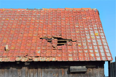 Close-up of broken roof of an Old Barn, Hesse, Germany Stock Photo - Premium Royalty-Free, Code: 600-08002599