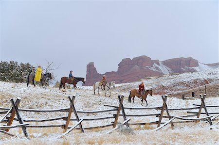 Cowboys with Two Young Cowboys Riding Horses in Snow, Rocky Mountains, Wyoming, USA Stock Photo - Premium Royalty-Free, Code: 600-08026179