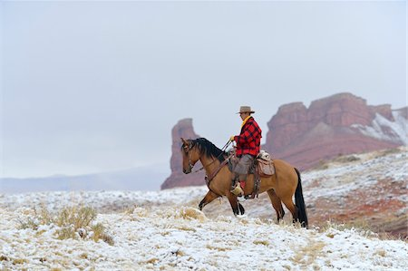 Cowboy Riding Horse in Snow, Rocky Mountains, Wyoming, USA Stock Photo - Premium Royalty-Free, Code: 600-08026182