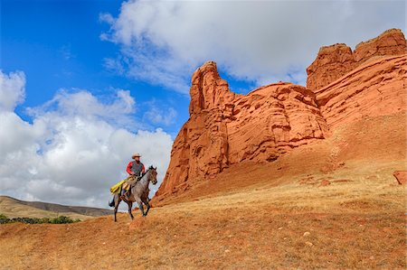 Cowboy Riding Horse, Wyoming, USA Stock Photo - Premium Royalty-Free, Code: 600-08026199