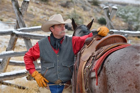 Portrait of Cowboy Standing near Horse, Rocky Mountains, Wyoming, USA Stock Photo - Premium Royalty-Free, Code: 600-08026190
