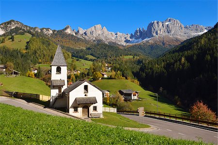 The Little Church San Cipriano, San Cipriano (view towards Catinaccio, Rosengarten), in autumn, UNESCO World Heritage, Tiers, Val di Tires, Tierser Tal, Bolzano District, Trentino-Alto Adige, South Tyrol, Dolomites, Italy Stock Photo - Premium Royalty-Free, Code: 600-08026204