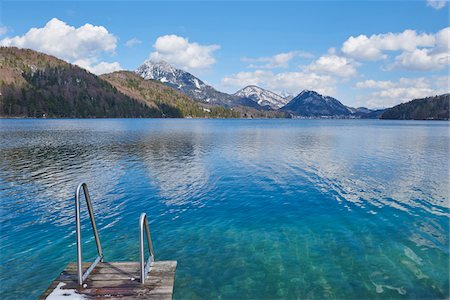 Dock on Fuschlsee with Mountains in the background in Early Spring, Austria Stock Photo - Premium Royalty-Free, Code: 600-08022748