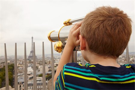 places - Boy Looking through Viewer over City to Eiffel Tower from Arc de Triomphe, Paris, France Stock Photo - Premium Royalty-Free, Code: 600-08059869