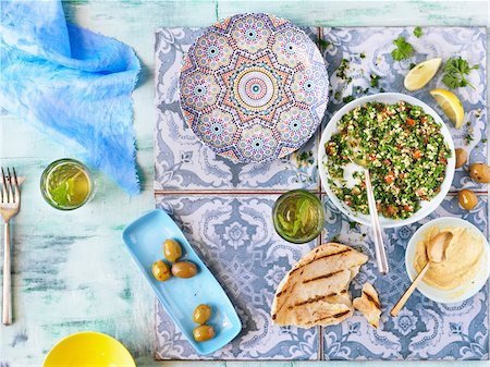 salad - Overhead View of Middle Eastern Meal with Pita Bread, Tabouleh, Hummus and Olives Stock Photo - Premium Royalty-Free, Code: 600-08060032