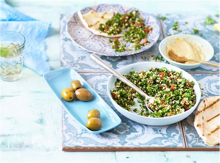 Middle Eastern Meal with Pita Bread, Tabouleh, Hummus and Olives Stock Photo - Premium Royalty-Free, Code: 600-08060033