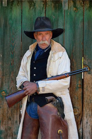 Portrait of Cowboy with Rifle, Shell, Wyoming, USA Stock Photo - Premium Royalty-Free, Code: 600-08082884