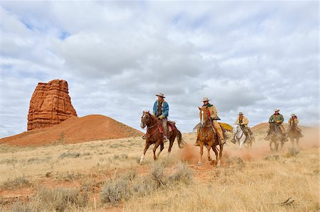 five animals - Cowboys and Cowgirls Riding Horses with Castel Rock in the background, Shell, Wyoming, USA Stock Photo - Premium Royalty-Free, Code: 600-08082906