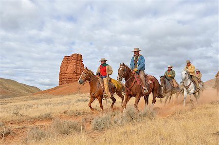 Cowboys and Cowgirls Riding Horses with Castel Rock in the background, Shell, Wyoming, USA Fotografie stock - Premium Royalty-Free, Codice: 600-08082909