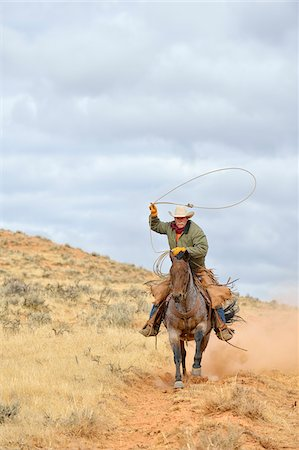 Cowboy Riding Horse with Lasso in Hand, Shell, Wyoming, USA Stock Photo - Premium Royalty-Free, Code: 600-08082911