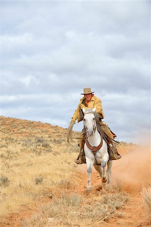 Cowboy Riding Horse with Rope in Hand, Shell, Wyoming, USA Stock Photo - Premium Royalty-Free, Code: 600-08082912