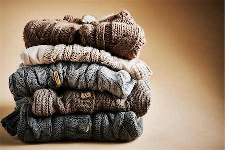 Stack of five cardigans, studio shot on brown background Stock Photo - Premium Royalty-Free, Code: 600-08107047