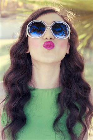 Portrait of Young Woman Blowing Kisses, Italy Stock Photo - Premium Royalty-Free, Code: 600-08102808