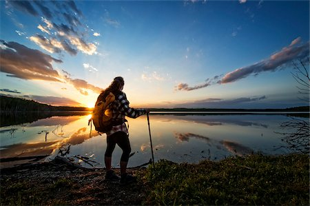 Hiker by Calm Lake at Sunset, Saskatchewan, Canada Stock Photo - Premium Royalty-Free, Code: 600-08102820