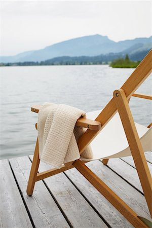 Deck Chair with Towel on Dock, Tirol, Austria Stock Photo - Premium Royalty-Free, Code: 600-08145741